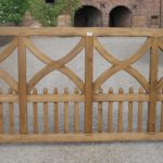 Wooden driveway gates with crosses